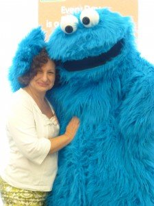 Sesame Street's Walkabout Cookie Monster shared hugs with Ronna at EVERY DAY IS A READING AND WRITING DAY event.