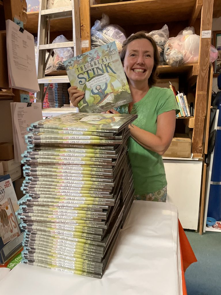 Colleen with her new book at local indie Once Upon a Time